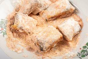 Hake Fish in the flour with red paprika