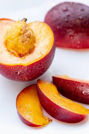Half-and-sliced-peach-nectarine-slices-on-white-background.jpg
