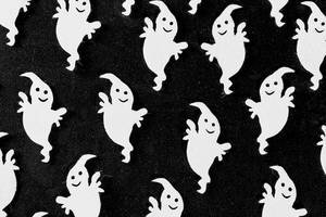 Halloween background with white ghosts decor