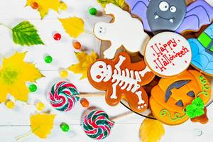 Halloween gingerbread and candies with yellow leaves