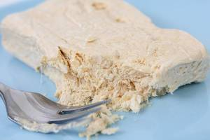 Halva candy with Vanilla with fork on the plate (Flip 2019)
