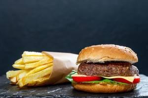 Hamburger and fries on black background (Flip 2019)
