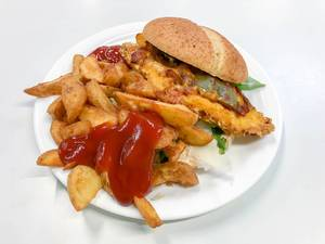 Hamburger bread filled with crispy patty, aubergine, rocket and parmesan slices, with brown baked french fries with ketchup