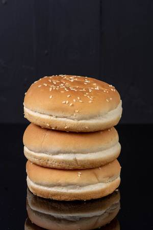 Hamburger Buns isolated above black background (Flip 2019)