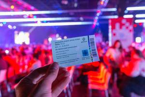 Hand holds an exclusive Gamescom event arena ticket  for the ESL championship summer season