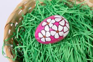 Hand painted egg in a basket
