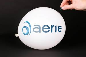 Hand uses a needle to burst a balloon with Aerie Pharmaceuticals logo