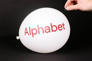 Hand uses a needle to burst a balloon with Alphabet Inc logo