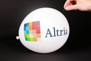 Hand uses a needle to burst a balloon with Altria logo