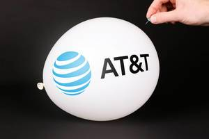 Hand uses a needle to burst a balloon with AT&T logo