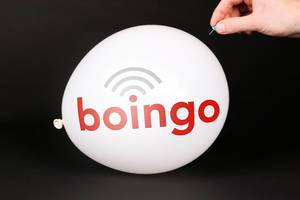 Hand uses a needle to burst a balloon with Boingo Wireless logo