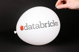 Hand uses a needle to burst a balloon with Databricks logo