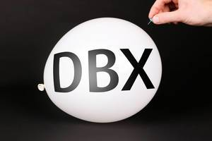 Hand uses a needle to burst a balloon with DBX text