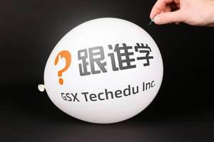 Hand uses a needle to burst a balloon with GSX Techedu logo