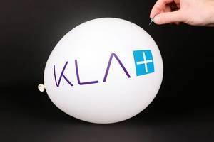 Hand uses a needle to burst a balloon with KLA logo