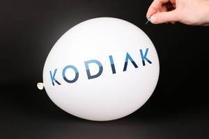 Hand uses a needle to burst a balloon with Kodiak Sciences logo