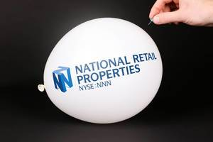 Hand uses a needle to burst a balloon with National Retail Properties logo