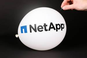 Hand uses a needle to burst a balloon with NetApp logo