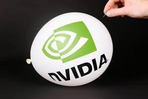 Hand uses a needle to burst a balloon with Nvidia logo