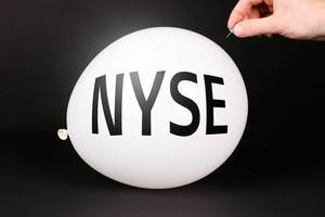 Hand uses a needle to burst a balloon with NYSE text