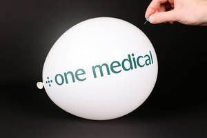 Hand uses a needle to burst a balloon with One Medical logo