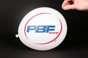 Hand uses a needle to burst a balloon with PBF Energy logo