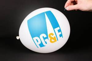 Hand uses a needle to burst a balloon with PG&E logo