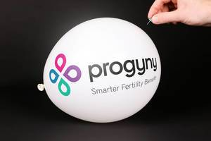 Hand uses a needle to burst a balloon with Progyny logo