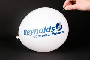 Hand uses a needle to burst a balloon with Reynolds Consumer Products logo