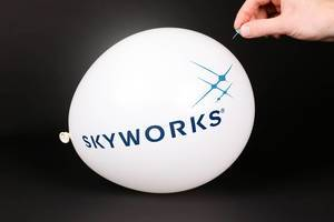 Hand uses a needle to burst a balloon with Skyworks logo