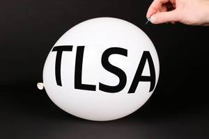 Hand uses a needle to burst a balloon with TLSA text