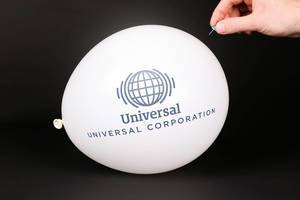 Hand uses a needle to burst a balloon with Universal Corporation logo