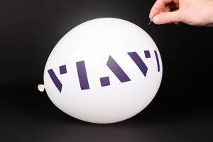 Hand uses a needle to burst a balloon with Viavi Solutions logo