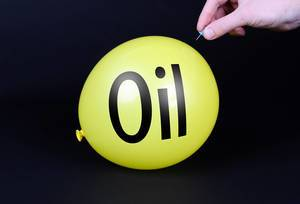 Hand uses a needle to burst a yellow balloon with Oil text