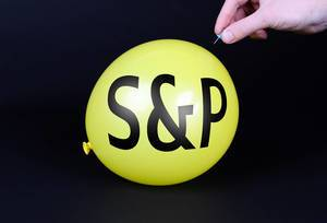 Hand uses a needle to burst a yellow balloon with S&P text
