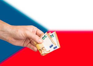 Hand with Euro banknotes over flag of Czech Republic