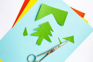 Handicraft work of coloured paper for christmas trees