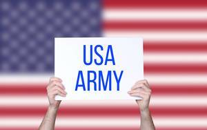 Hands holding board with USA Army text with USA flag background