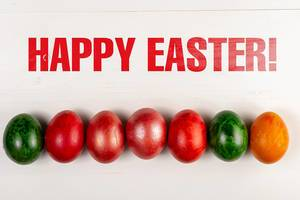 Happy Easter text with Colored Easter Eggs