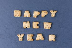 Happy New Year biscuits letters, black background