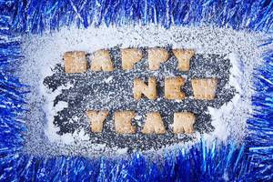 Happy new year, Christmas decoration with snow, biscuit letters