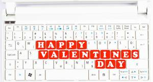 Happy Valentines day text on computer keyboard