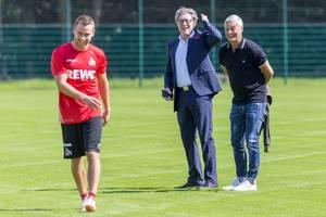 Harald Schumacher, Armin Veh und ein Spieler lachen zusammen