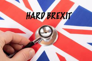 Hard Brexit text on a British flag with stethoscope