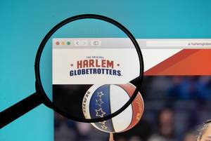 Harlem Globetrotters logo on a computer screen with a magnifying glass