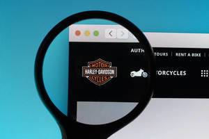 Harley-Davidson logo under magnifying glass