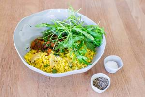 Harvest Tajine Bowl: morrocan vegetable with dried fruit, fresh herbs, roasted almonds and safran bulgur
