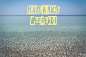 Have a nice weekend writing on a clear water sea view