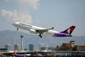 Hawaiian Airlines plane taking off from Las Vegas Airport, LAS