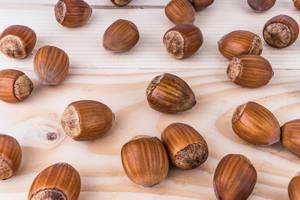 Hazelnuts on the wooden board